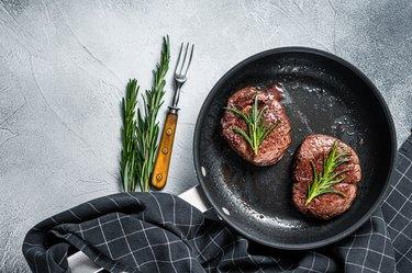 Roasted Filet Mignon tenderloin meat beef steaks in pan