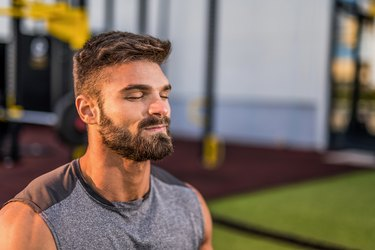 young man in the gym breathing through his nose during a breath-based interval workout