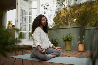 woman meditating, as a natural remedy for eczema