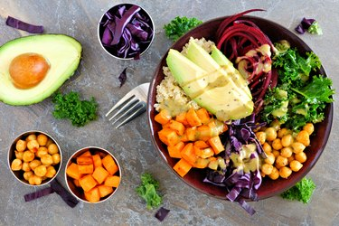 top view of a buddha bowl with colorful fruits and vegetables to represent foods to eat on a COPD diet