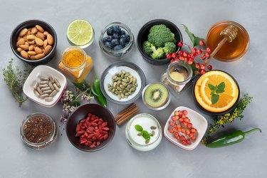 Top view of healthy ingredients like apple cider vinegar, garlic and honey