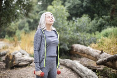 Senior Woman Living with COPD Breathes Calmly During Workout