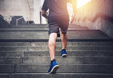 Man walking up stairs during workout