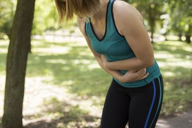 Fit woman having stomachache