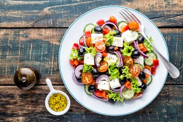 top view of a bowl of greek salad, as an example of food on an obesity diet plan