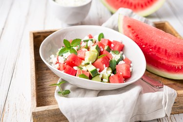 Mediterranean watermelon salad with Feta cheese, cucumber and mint leaves