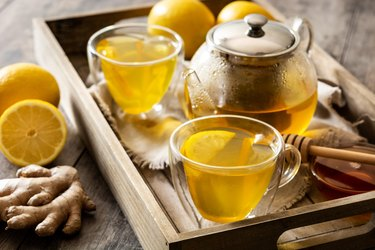 Ginger tea with lemon and honey in crystal glass
