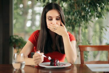 Woman Feeling Sick From Eating Chocolate Cake