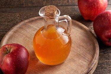 Apple cider vinegar in a bottle on a table