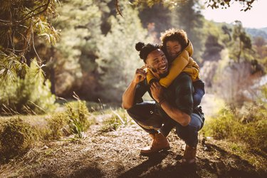 A father and son spending time in nature as a way to promote heart health