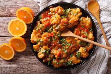 orange chicken in sweet and sour sauce close-up. horizontal