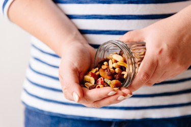 Nuts and dried fruits in hands
