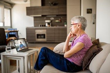 Senior woman in online cognitive therapy, as a natural remedy for vertigo