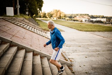 Older man running up steps, as a natural remedy for enlarged prostate