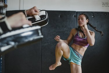 woman practicing muay thai as a form of self-care