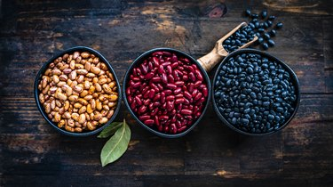 Pinto beans, kidney beans and black beans shot from above