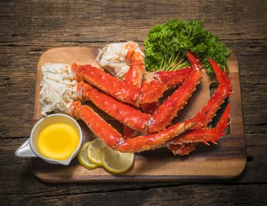 Vitamin B12-rich Alaskan King Crab legs with butter and lemons.