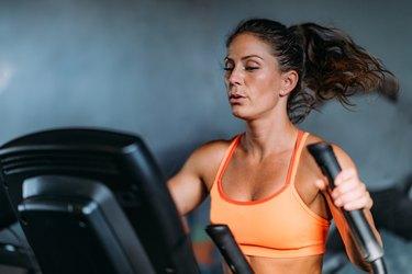 Woman Exercising on Elliptical Cross Trainer