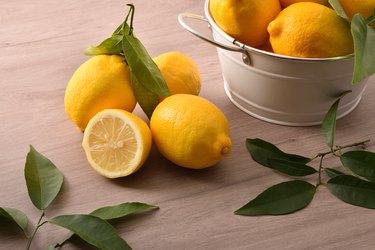 Lemons basket on wooden kitchen bench elevated