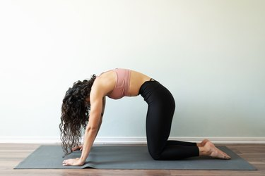 Athletic woman with activewar exercising with a yoga routine