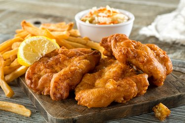 Fish and Chips on a Wooden Board
