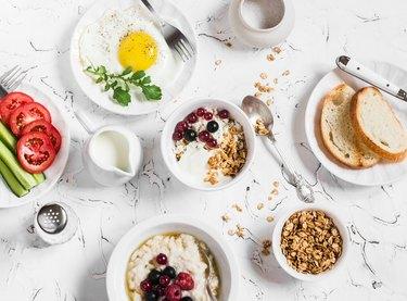 Breakfast - cottage cheese, yogurt, berries, oatmeal, fried egg, vegetables