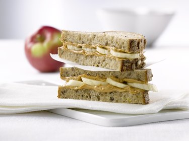 Peanut butter sandwich on whole-wheat bread, as an example of one of the best snacks for low blood sugar
