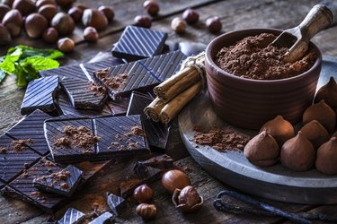 histamine-rich chocolate truffles and bars on wooden table