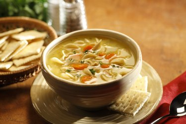 Serving of sodium-rich chicken noodle soup in a bowl