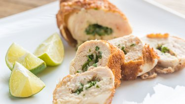 Pre-Made Chicken Kiev on a Plate and Lime Wedges