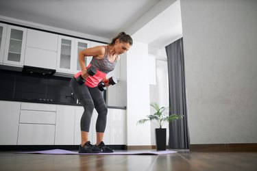 Woman performing isometric row back exercise