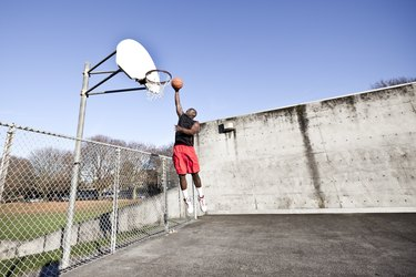 African American man playing basketball, working on his vertical jump