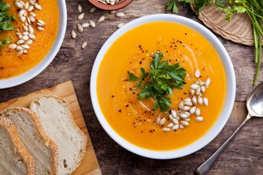 Homemade Pumpkin Soup topped with pumpkin seeds
