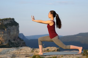 Asian woman practicing tai chi exercise outdoors