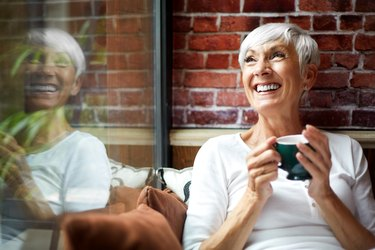 older woman drinking green tea to reduce inflammation