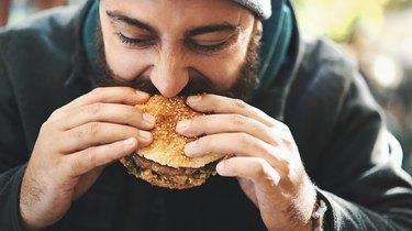 Man eating a fast food burger
