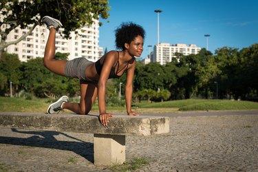 Fitness Woman Doing Glute Kickbacks During a Butt Workout
