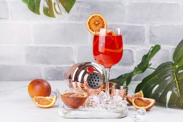 Summer sangria cocktail histamine-rich alcohol on table with orange slices