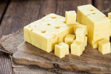 Vitamin B12-rich Swiss cheese on cutting board.