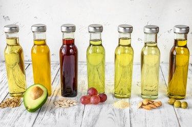 Assortment of vegetable oils in glass bottles