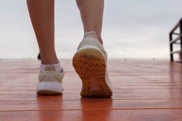 closeup of female wearing walking shoes taking steps