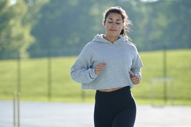 Beautiful and fit woman running