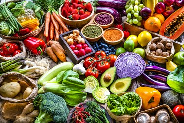 Fresh organic fruits, vegetables and legumes background