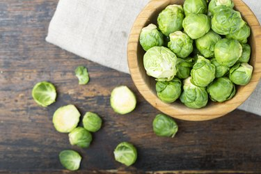 Estrogen-rich brussels sprouts in a wooden bowl. Harvesting.