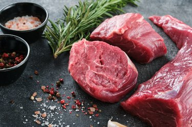 Raw filet mignon steaks with herbs and spices, Raw fresh marbled meat Steak.