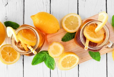 Summer iced tea above view table scene on a white wood background
