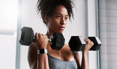 closeup of a strong woman doing Zottman curls for strong biceps