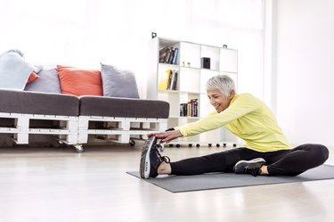 Senior woman Exercising and Having Workout For Legs