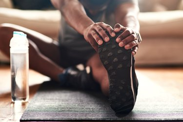man stretching after exercise, as a natural remedy for acid reflux