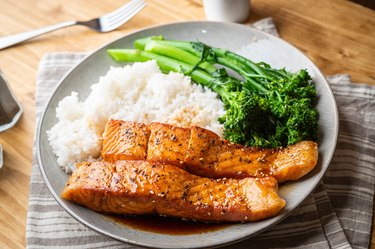 Honey salmon on plate, served with white rice and broccoli.